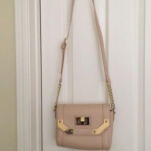 "Handbags - "".            ""7x "" depth "".  8"" across"